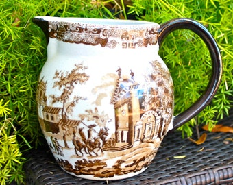 Brown transfereware pottery pitcher