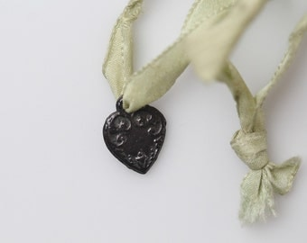 Vintage Embossed Heart Pendant - Tiny Dark Metal Embossed Heart Charm on Green Ribbon Tie - Found Jewelry Object