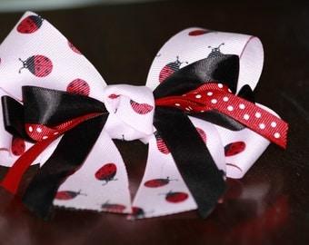 Pink, black and red lady bug polka dot hair bow