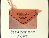 """Track your parcel with delivery confirmation. """"POSTMAN signature required"""""""