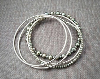 Stacking bracelet set in sterling silver with sea green pearls