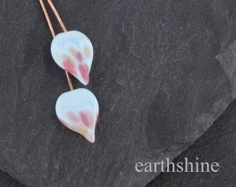 Pair of pink and blue handmade lampwork glass spade headpins. Earring pair