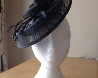 Black Oval Disc Sinamay and Feather Fascinator on crocodile clip races, weddings, Kentucky Derby, Royal Ascot, Melbourne Cup