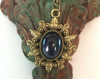 Antiqued Bronze Pendant with Vintage Montana Blue Glass Cabochon with Antiqued Bronze Chain