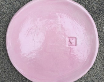 Small, flat, shell pink plate with embossed heart