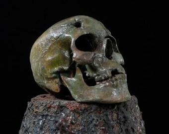Bullet Hole Skull w/ machette gash. Aluminum skull. Zombie kill.