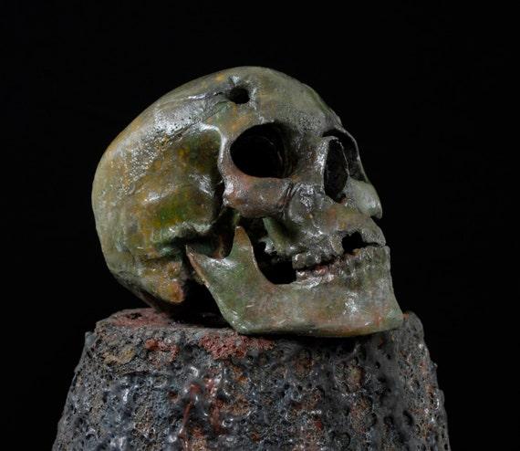 Bullet Hole Skull w/ machette gash. Aluminum skull. Zombie