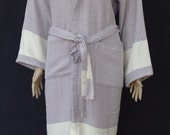 Women's bright lilac colour diamond patterned Turkish thick peshtemal soft cotton hooded bathrobe, dressing gown.