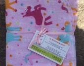 Pink ponies XL single layer flannel receiving blanket.