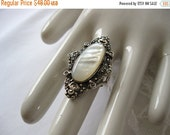 ON SALE vintage. RING. large. Marcasite. mother of pearl. Statement. Size 7.