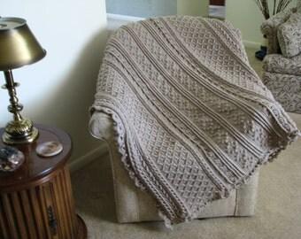 Taupe crocheted Aran afghan