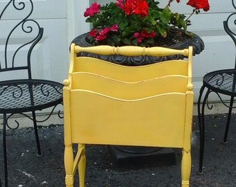 Vintage sunflower yellow magazine stand