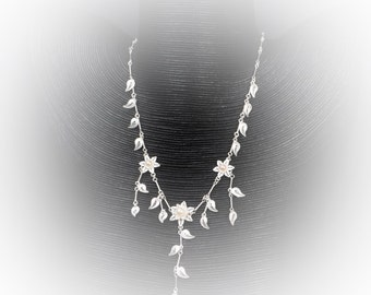 Necklace petal of love in silver embroidery