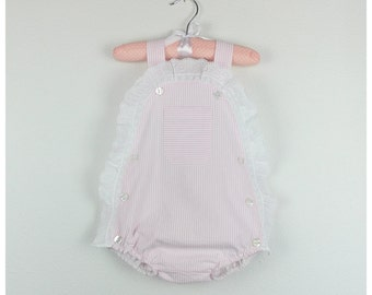 Baby Girl romper - Pink seersucker cotton romper with front pocket and lace trim details