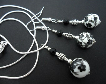A hand made black  and white porcelain bead  necklace and earring set.