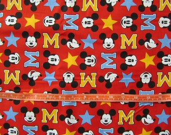 Red with Mickey Faces/Letter M Toss Cotton Fabric by the Yard