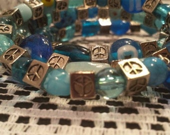 Blue and silver memory wire bracelet, peace, block, peace sign