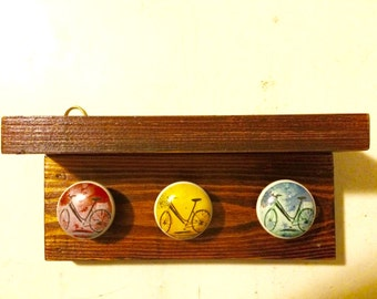 Cycling Regalia Reclaimed Wood Shelf and Bicycle Knobs for the cycle enthusiast!