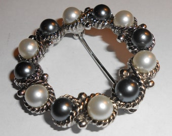 "Vintage AVON ""Eclipse"" Silver Tone Braided Rope Surrounding Black and White Faux Pearl Open Circle Wreath Brooch"
