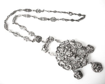 Vintage Ornate Renaissance Revival Peruzzi Style Silver Pendant Necklace With Cherubs and Roman Masks
