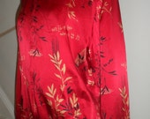 notations silk asian chinese  red jacket writing and floral leaf design   blacks golds 80s 90s