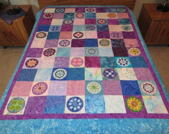 Small quilted comforter in machine embroidered batik fabrics