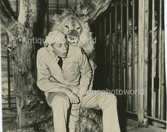 Young soldiers hugged by lion antique photo