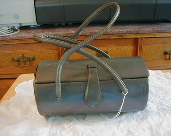 Lovely grey leather purse Theodor of California  from the 1940's.  Barrell style with 2 leather handles and snap closure.
