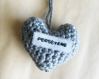 Gray affirmation heart pillow: Persevere