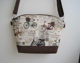Brown and beige bicycle print cross body/ arm purse