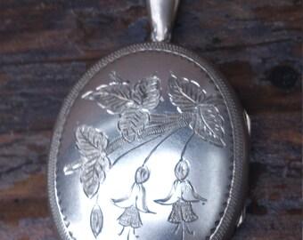 Huge vintage silver oval shaped locket