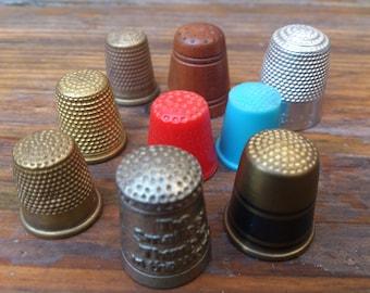 lot of nine vintage thimbles