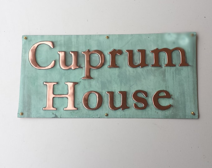 "Copper Plaque in Garamond font, 2"" characters on one or two lines, polished, laquered and patinated o"