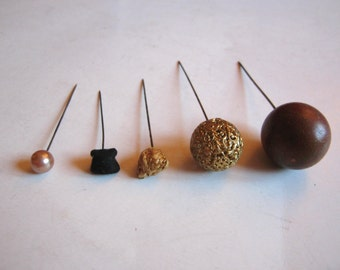 collection of five antique hatpins