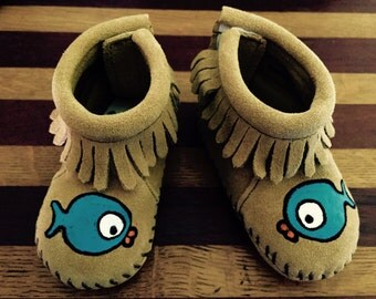 Two blue fish moccasins