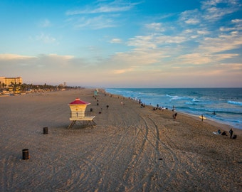 View of the beach at sunset, in Huntington Beach, California.   Photo Print, Stretched Canvas, or Metal Print.