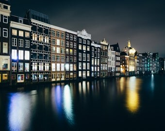 Buildings along the Damrak canal at night, in Amsterdam, The Netherlands - Photography Fine Art Print or Wrapped Canvas