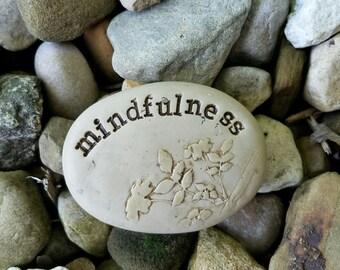 Mindfulness meditation clay stone, textured zen pebble