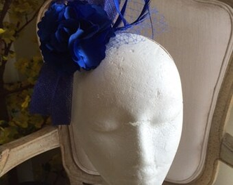 Blue loop fascinator with netting, feathers and satin flower on a headband!