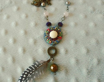 Hanging with feathers and beads. Available.