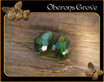 10 dark green coloured tear drop beads 4x6mm