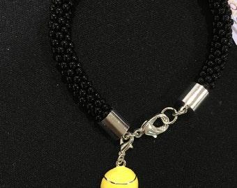 Yellow Enamel Tennis Ball on Black Beaded Woven Bracelet