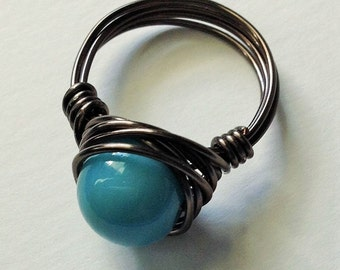 Medium blue Czech glass bead wire wrapped ring