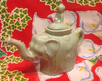 Vintage Celadon ceramic teapot with lady riding atop as the lid- Asia