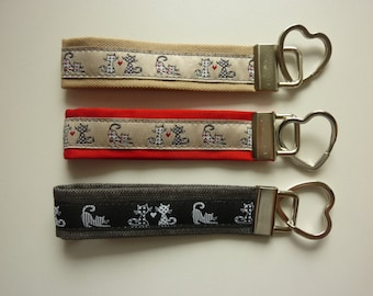 "Key fob ""Cats"" in beige, black or red"