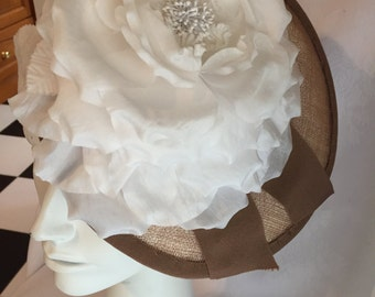 Beige fascinator with white rose