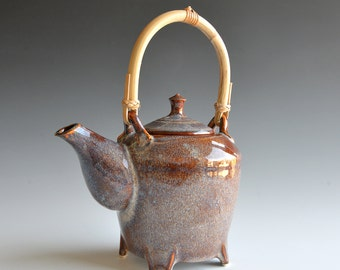 Handthrown teapot in porcelain with rattan handle