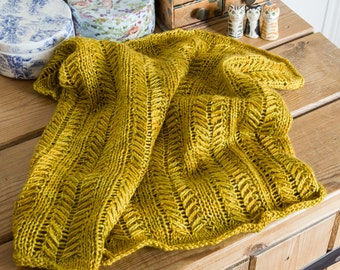 Handknit Cowl in a golden yellow with a slight green cast, reminiscent of early Autumn colours, knit in the round with feather like cables