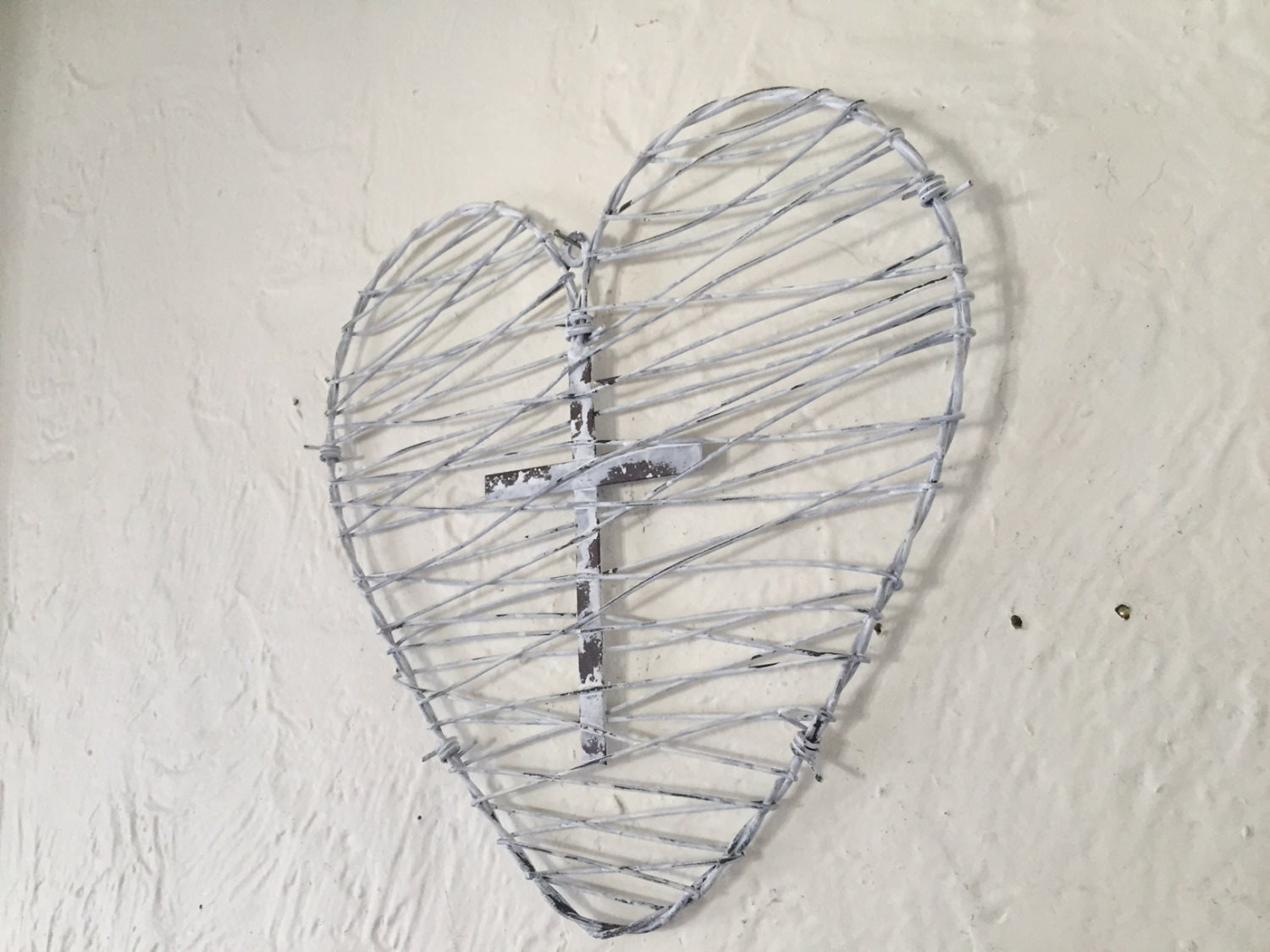 metal barbed wire heart with intertwined cross, white distressed ...