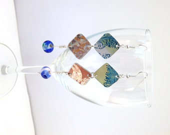 Dangle green and brown aluminium earrings with blue beads